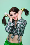 Funny cute smiling woman with pigtails  on green Royalty Free Stock Photos