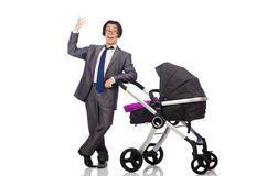 The funny dad with baby and pram on white Stock Photography