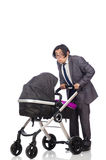 The funny dad with baby and pram on white Royalty Free Stock Photos