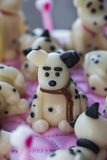 Funny Dalmatian puppies of marzipan on the cake Stock Photos