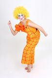 Funny dancing clown in costume Royalty Free Stock Photos
