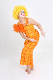 Funny dancing clown in costume Stock Photo