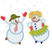 Funny dancing snowmen. In the snow Stock Images