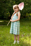 Funny, dark-haired girl with a butterfly net Royalty Free Stock Image