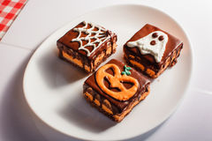 Funny delicious cakes for Halloween on the table. horizontal view from above.  Royalty Free Stock Image