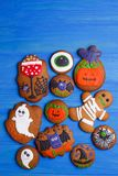 Funny delicious ginger biscuits for Halloween on the table, flat stock image