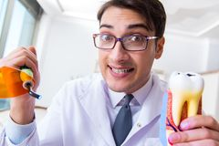 The funny dentist with curing light in medical concept royalty free stock photography