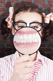 Funny Dentist Showing White Teeth And Big Smile. Female Student At The Dentist Showing Big White Teeth With A Big Smile In A Depiction Of School Dental Care Royalty Free Stock Images
