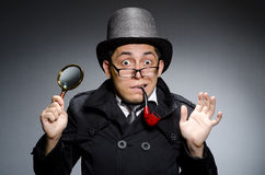 Funny detective with pipe Royalty Free Stock Photography
