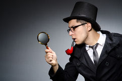 Funny detective with pipe. And hat Stock Photography
