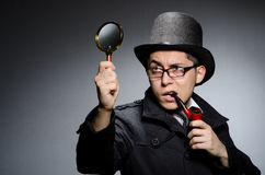 Funny detective with pipe Royalty Free Stock Photo