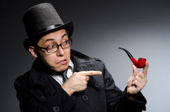 Funny detective. With pipe and hat royalty free stock image