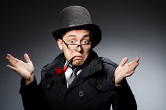 Funny detective with pipe Royalty Free Stock Images