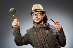 Funny detective with smoking pipe Royalty Free Stock Photography
