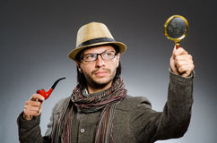 Funny detective with smoking pipe Stock Photo