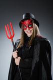 The funny devil in halloween concept Stock Photos