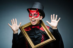 Funny devil with picture Royalty Free Stock Photography