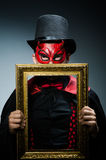 Funny devil with picture Stock Photo