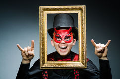 Funny devil with picture Royalty Free Stock Images