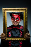 Funny devil with picture. Frame stock photography
