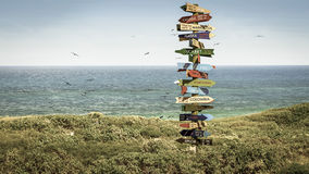 Funny directions signpost Stock Photo