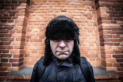 Funny disappointed shy man hiding in his cap Stock Image