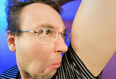Funny disgusted man in glasses portrait. On vivid color background royalty free stock photography