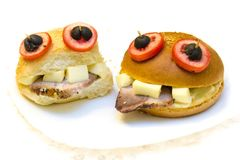 Funny dish - frog is a great food for the cannibal. An interesting idea for joint creativity with a child - funny and delicious sandwiches in the form of frogs Royalty Free Stock Image