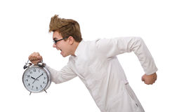Funny doctor with alarm clock Royalty Free Stock Images