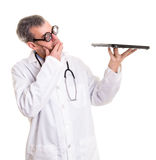 Funny Doctor Examines a laptop computer Royalty Free Stock Image