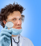 Funny doctor listens with stethoscope Stock Photo