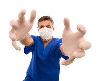 Funny doctor with long hands. Funny doctor with surgical mask and long hands Royalty Free Stock Image