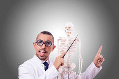 Funny doctor with skeleton isolated on white Royalty Free Stock Image