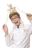 The funny doctor with skeleton isolated on white Royalty Free Stock Photography
