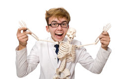 The funny doctor with skeleton isolated on white Stock Image
