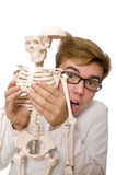 Funny doctor with skeleton isolated on white Stock Images