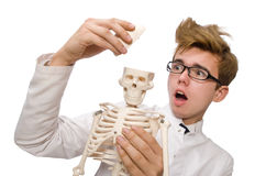 Funny doctor with skeleton isolated on white Royalty Free Stock Images
