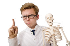 The funny doctor with skeleton on white Royalty Free Stock Images