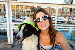 Funny dog and woman on summer vacation travel. Happy woman with funny dog having fun together on summer travel to Asturias, Spain Stock Images