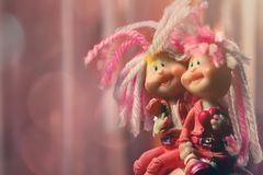 Funny dolls with long dreadlocks play a loving couple stock image