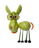 Funny donkey made of green tomato. On white background Stock Images