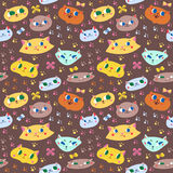 Funny doodle cartoon cats seamless vector pattern. (on the brown background Royalty Free Stock Photography
