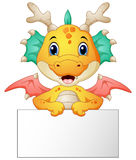 Funny dragon cartoon holding blank sign Stock Image