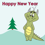 Funny dragon with christmas tree Stock Photos