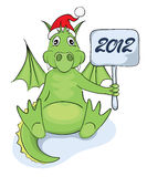 Funny dragon in Santa hat Royalty Free Stock Photo