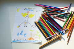 Funny drawing of the five-year-old child color pencils. Children's drawing representing a portrait of mother Stock Photos