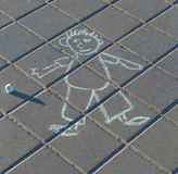 Funny drawing of a man by chalk on the asphalt Stock Image