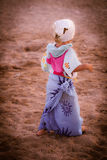 Funny dressed blond baby girl on the beach Stock Photography