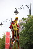 Funny dressed persons on stilts royalty free stock images