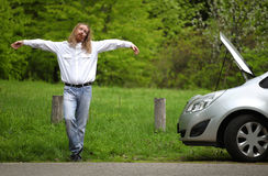 Funny driver praying a broken car Royalty Free Stock Photo
